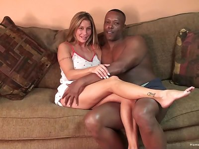 Silicone blonde gets her pussy pounded badly by a dark-skinned dude