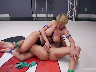 Voluptuous wrestling session with two busty pussy loving hotties